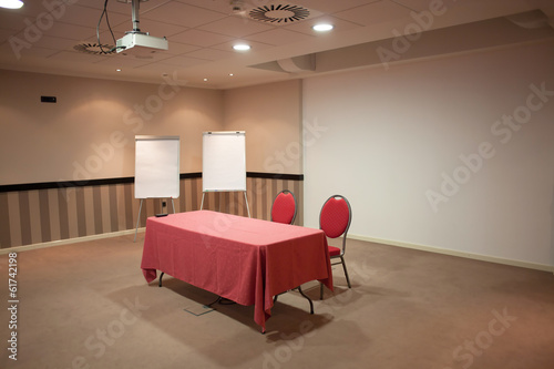 red table in empty classroom