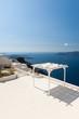 Obrazy na płótnie, fototapety, zdjęcia, fotoobrazy drukowane : Terrace with Sunshade on Santorini Greece