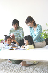 family sitting happily circle in living