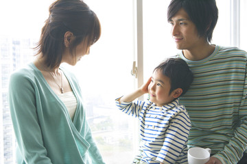 family relaxing by window