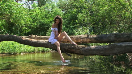 Brunette model posing on a riverside