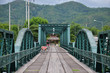 Tricycle thai style on Bridge over Pai River at Pai