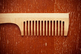 Wooden comb on a wooden table red. vintage style