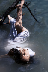 Fashion art photo of a girl lying in the water