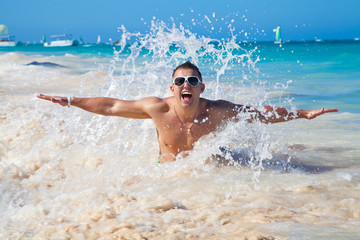 man in water waves of tropical sea