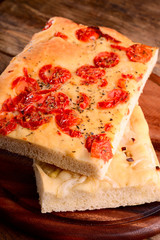 focaccia with little tomatoes and with onions