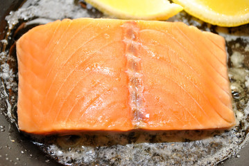 Raw Salmon with Butter and Lemon in a Fry Pan