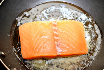 Salmon Searing in Lemon Juice and Butter in a Pan