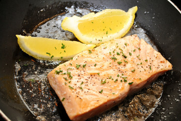 Cooking Salmon with Lemon, Butter, and Parsley