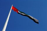 A skyward view of the UAE National Flag