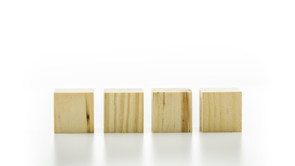 Four wooden cubes or building blocks