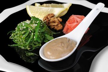 Chuka seaweed salad with peanut sauce, lemon and sesame seeds