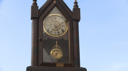 Old clock pendulum on sky