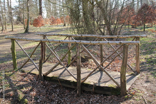 A Quaint Wooden Bridge in a Woodland Setting.