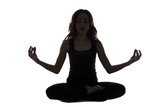Silhouette of a young woman in meditation pose