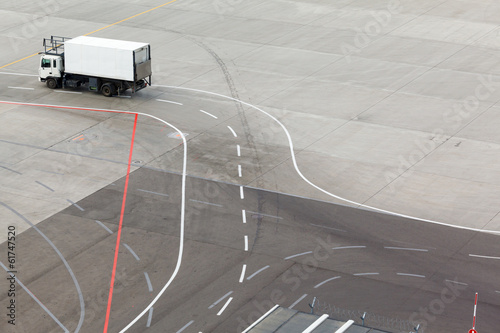 truck, airfield and markings on apron