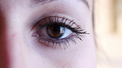 Woman eye with black mascara on lash close up