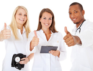 Medical team showing thumbs up