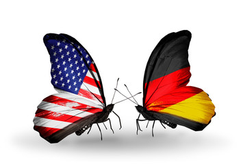 Two butterflies with flags USA and Germany