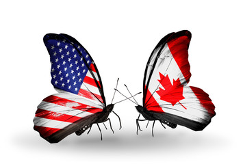 Two butterflies with flags  USA and Canada