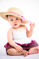Asian little baby girl smiling and posing with a hat