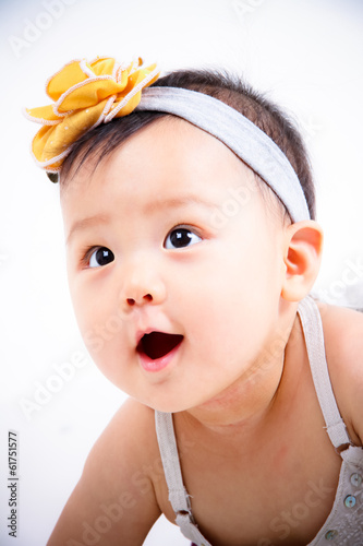 An adorable Asian little baby girl with a lovely handband