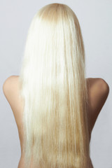 Blond Hair of Naked Girl. Back side of Young Woma