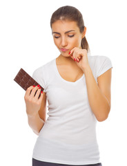 Young doubting girl with chocolate