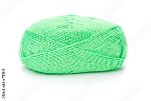 ball of green threads white background