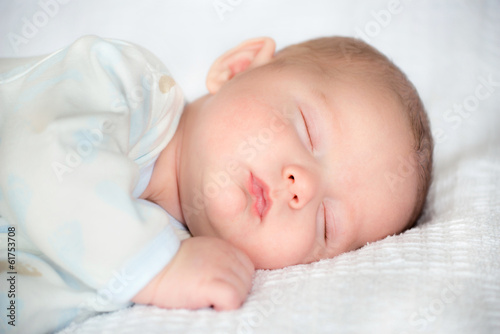 Infant baby boy sleeping peacefully