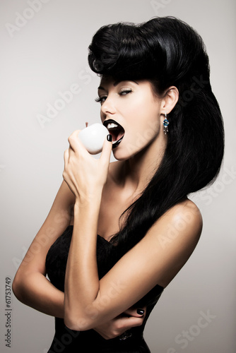 Fashion woman with modern hairstyle  with white apple