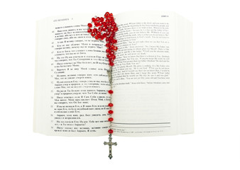 rosary and bible on white