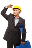 Senior man engineer  wearing protective helmet