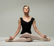 Beautiful young ballerina dancer meditating