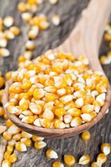corn in wooden spoon