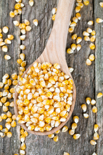 corn in wooden spoon