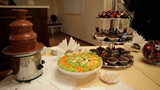 chocolate fountain and fruit on the table