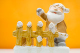 Yellow Santa Claus figurine