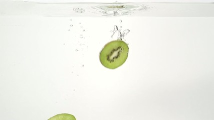 Parts of the kiwi and water splash in slowmotion