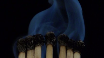 smoke from burnt matches in slowmotion