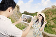 Asian tourist take picture at great wall china