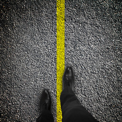 feet are on road