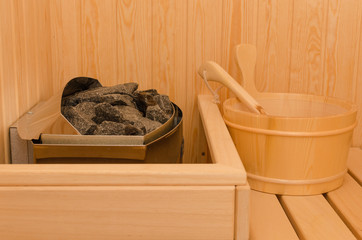 Sauna bath with heater and pail