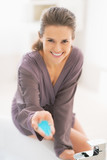 Happy young woman showing bath salt