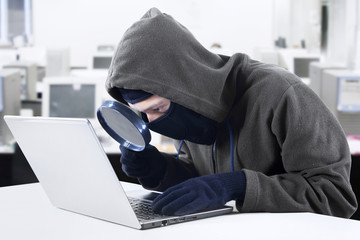 Hacker looking for information at office