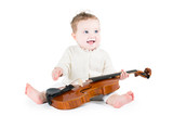 Sweet funny baby playing violin