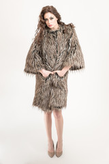 woman posing in fur coat