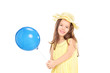 Cute little girl in yellow dress holding a blue balloon