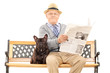 Senior gentleman sitting with his dog and reading newspaper