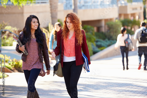 Female Students Walking Outdoors On University Campus